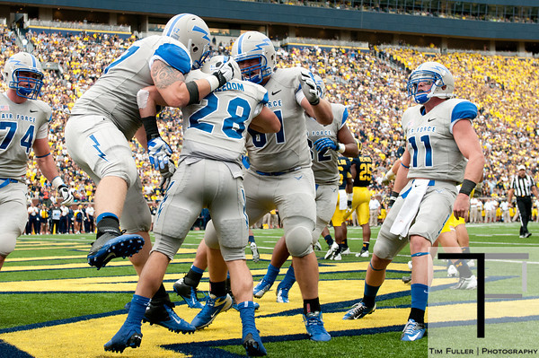 Sep 8, 2012; Ann Arbor, MI, USA; Air Force Falcons running back Cody Getz (28) celebrates his touchdown with teammates during the second quarter against the Michigan Wolverines at Michigan Stadium. Mandatory Credit: Tim Fuller-Air Force Academy Athletics