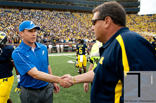 Sep 8, 2012; Ann Arbor, MI, USA; Air Force Falcons head coach Troy Calhoun (left) shakes hands with Michigan Wolverines head coach Brady Hoke (right) after the game at Michigan Stadium. Mandatory Credit: Tim Fuller-Air Force Academy Athletics