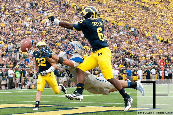 Sep 8, 2012; Ann Arbor, MI, USA; Air Force Falcons wide receiver Chris Jordan (8) reaches for the ball while being guarded by Michigan Wolverines defensive back Raymon Taylor (6) during the third quarter at Michigan Stadium. Mandatory Credit: Tim Fuller-Air Force Academy Athletics